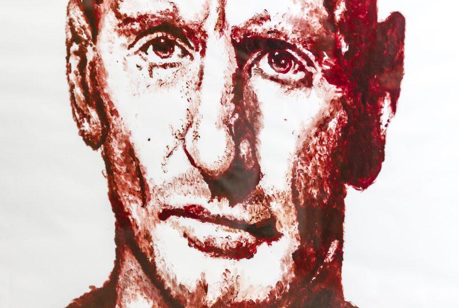 A red finger-paint portrait of Gareth Thomast of Garen