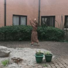 Lady singing outside the hospital