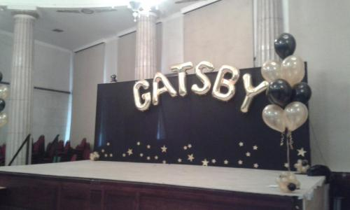 Stage Display. Giant Letters with large helium bouquets.