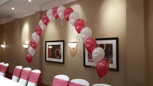 String Of Pearl Cake Arch in luxurious Ruby Red and White