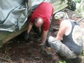Joe and Scott move rock in place to serve as in-fill between old logs and the ground.