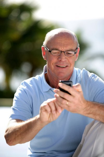 depositphotos_15749621-stock-photo-senior-sending-message-with-his[1]