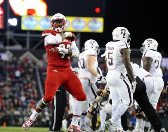 Dec 30, 2015; Nashville, TN, USA; Louisville Cardinals linebacker Devonte Fields (92) celebrates after a sack during the first half in the 2015 Music City Bowl at Nissan Stadium. Mandatory Credit: Christopher Hanewinckel-USA TODAY Sports