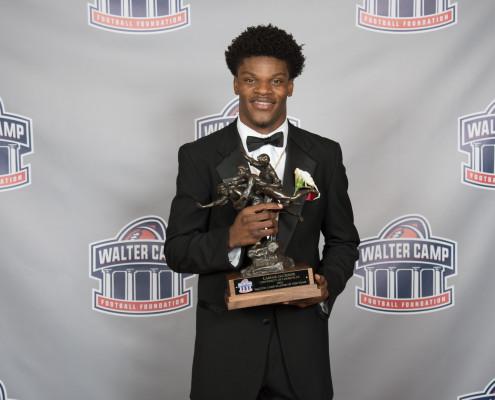 Lamar-with-WCPOY-Trophy-495x400-1.jpg