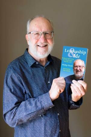 Philip Hunt holding his latest book: Leadership & Me