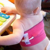 The CareAline Central Line Wrap Keeps lines off the skin and tucked away during playtime and during infusions.