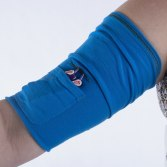 Slide the CareAline PICC sleeve up and feed the lines through the button hole and into the pocket