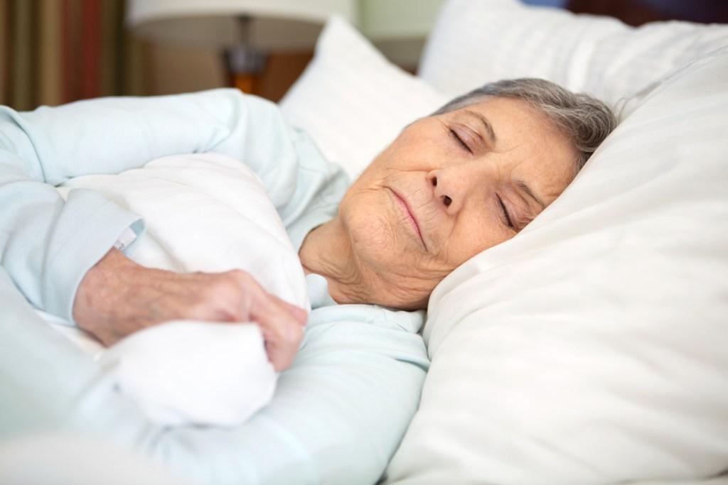 elderly woman sleeping while Living with Chronic Illness