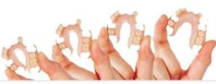 flexible denture being flexed between fingers