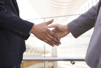 Handshake of men and women