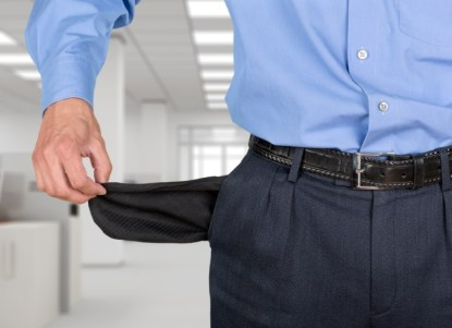 picture of a person's hand showing empty pockets