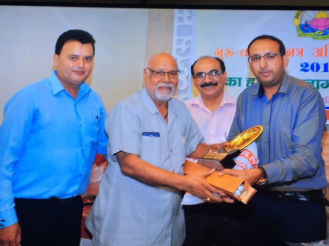 Respected Principal Dr.k.C Sharma being honored