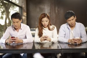 phubbing - people playing with cellphone snubbing others
