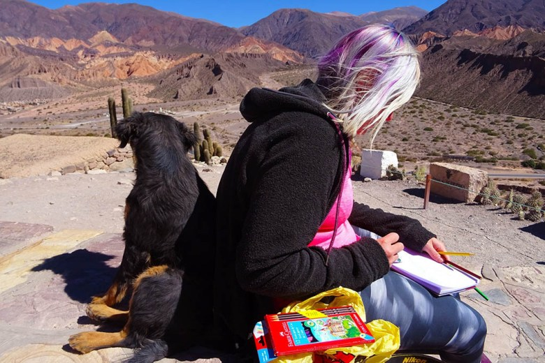 Lisa sketching and hanging out with a local dog we met at Pucará, near Tilcara