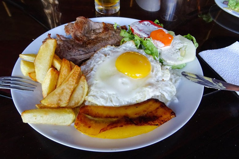 At amenú del dia restaurant in Nazca I had a main course of steak, plantain, egg, chips and salad
