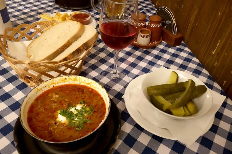 Kapustnica soup with wine and sides at the old-fashioned-cottage style Slovak Pub