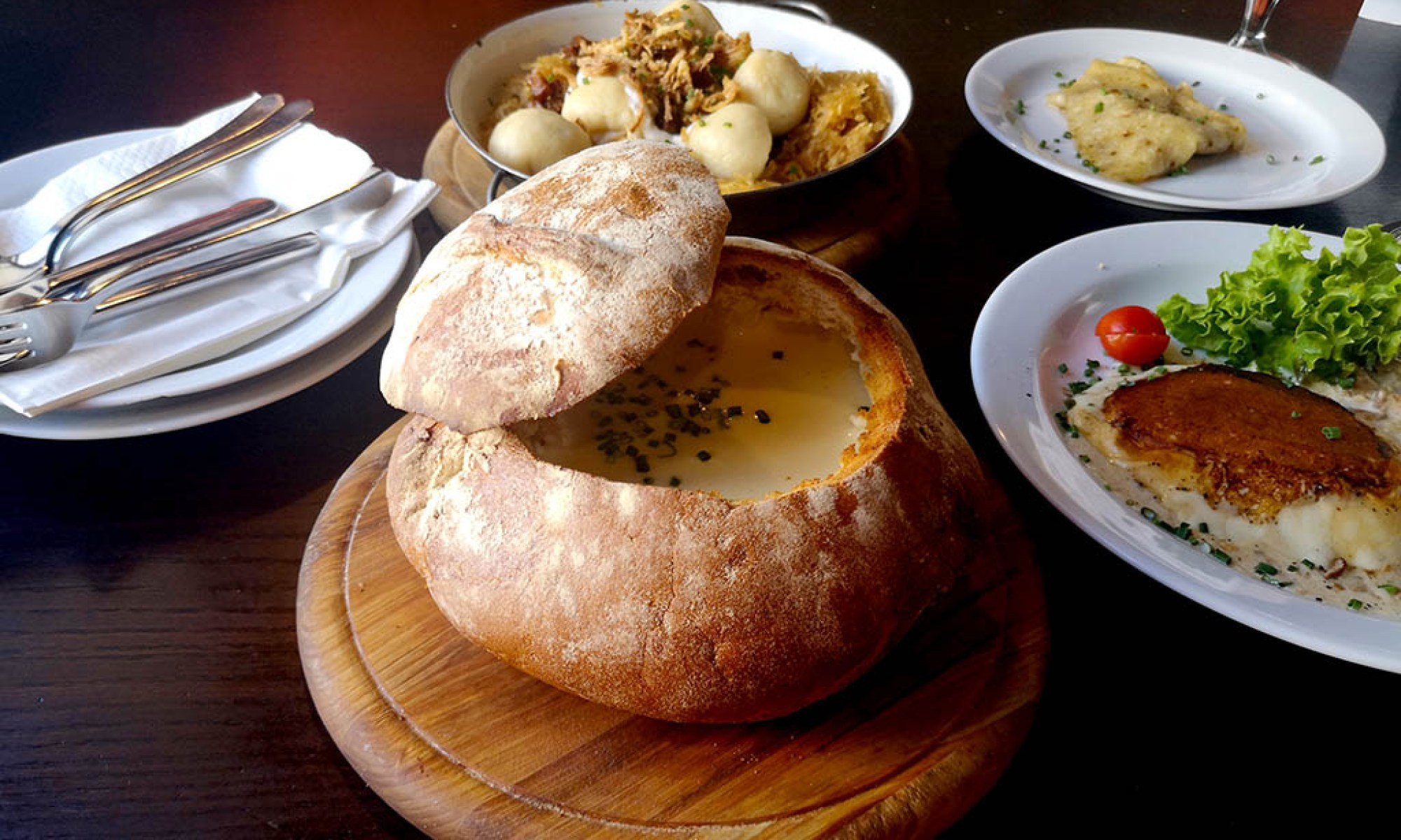 Creamy garlic soup served in a giant bread roll in Meštiansky Pivovar, Bratislava's oldest brewery