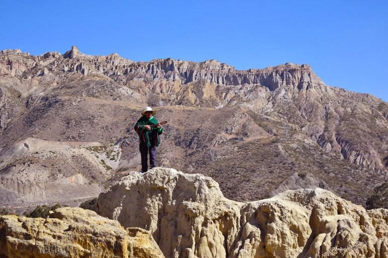 Man playing a charanga in Valle de la Luna, near La Paz