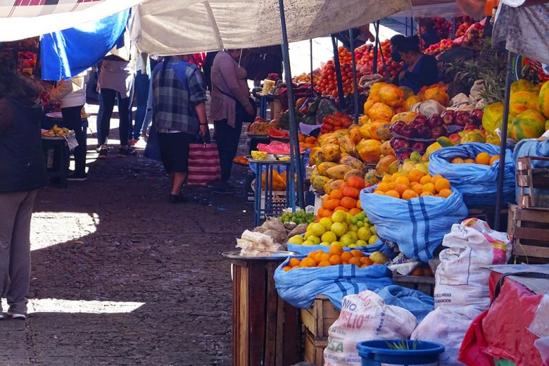 Shopping for fresh produce in local markets, like this one in Sucre, is a great way to save money on food