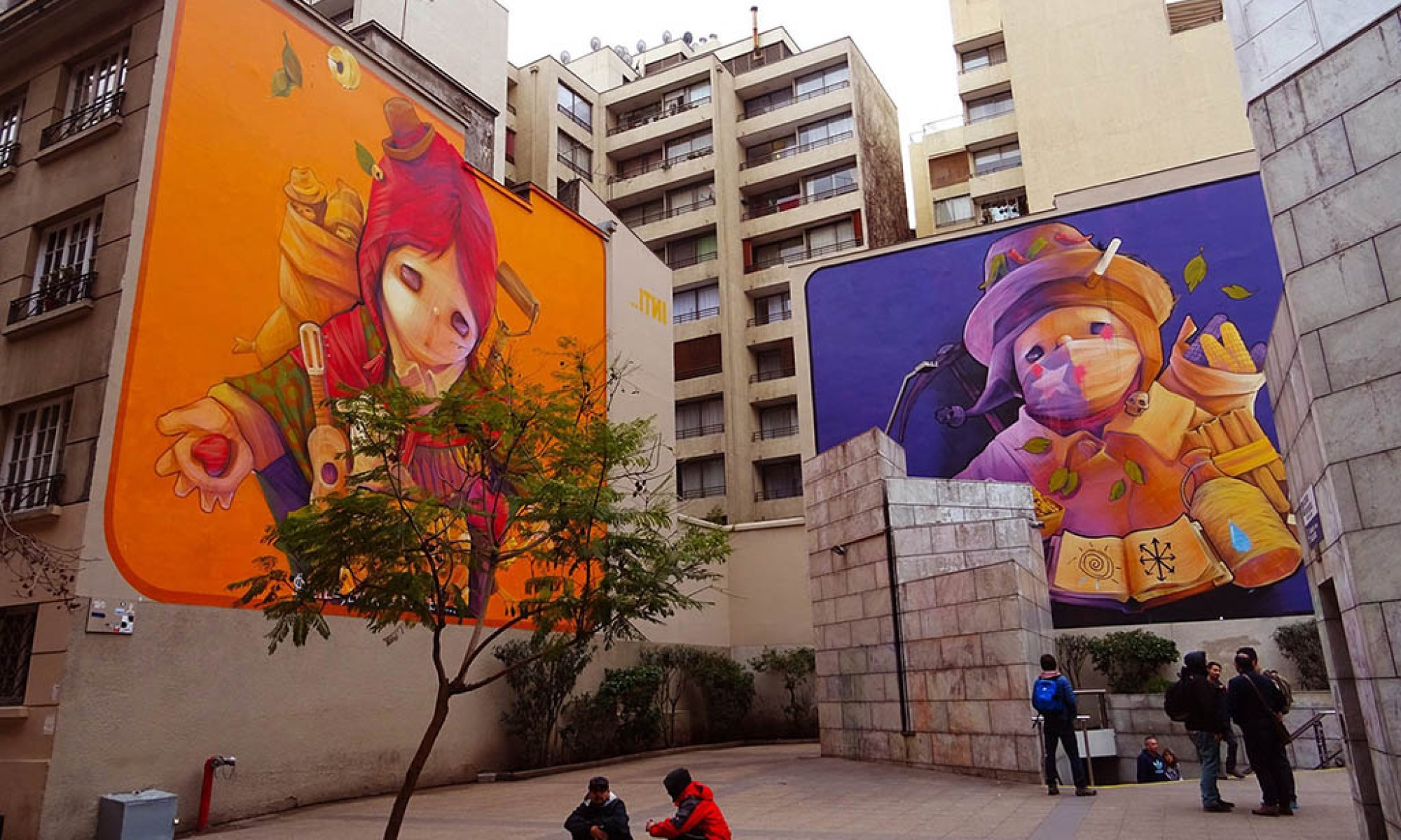 Two giant street murals by the Chilean artist Inti in central Santiago