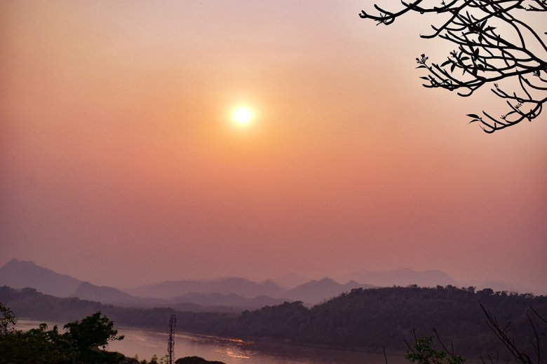The Mekong arcs to the west of Luang Prabang, making for spectacular river sunsets