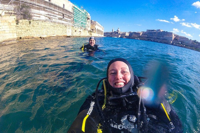 Emerging after diving the X127 wreck with the Basilica of Our Lady of Mount Carmel in the background