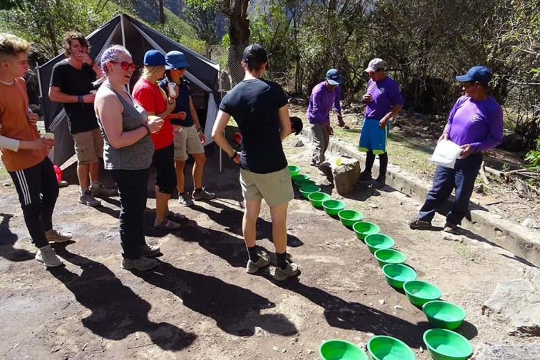 Porters setting up our washing bowls during lunch break on the Inca Trail