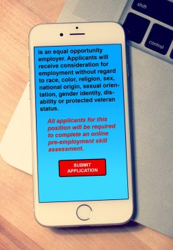 An iPhone screen with text indicating applicants will be required to complete an online pre-employment skill test.