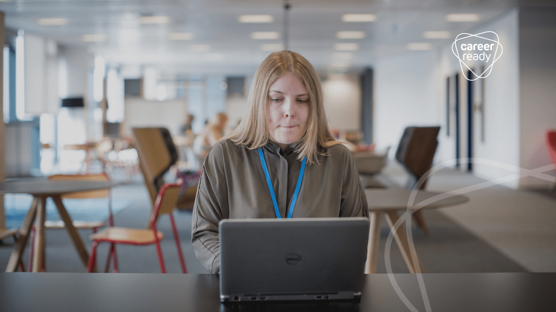 A student sits at a laptop working