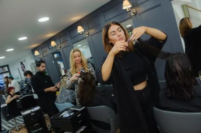 hairdressers cutting hair in Rush Dorking Hair salon