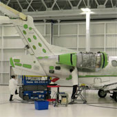 Engineers work on an airplane at the Embraer factory in Brevard. Credit: Greg Allen/NPR
