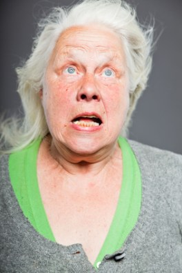 Senior woman white grey hair with expressive emotional face and hands. Studio shot isolated on grey background.