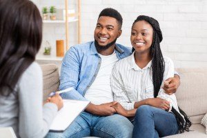 couple at first prenatal appointment with pregnancy doctor