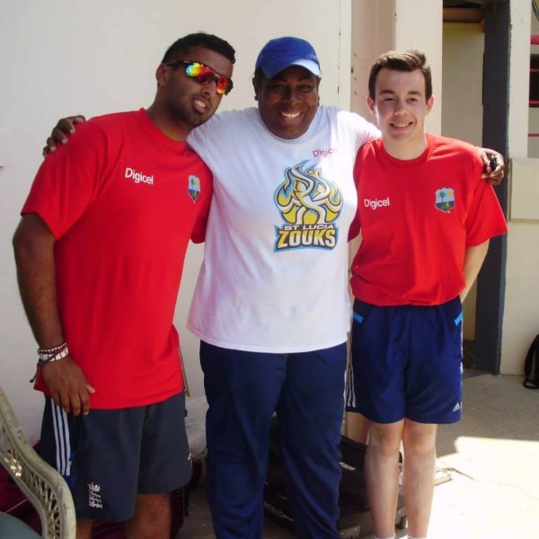 Cricket volunteers help at coaching clinic