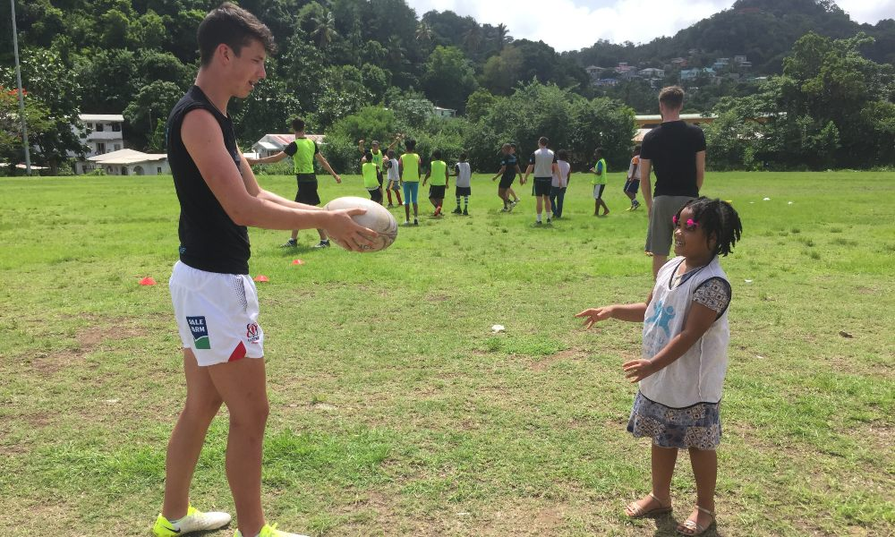 Volunteer rugby coach working with a community group in St Lucia