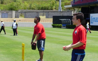 Volunteers help coach at the National Cricket Development Clinic