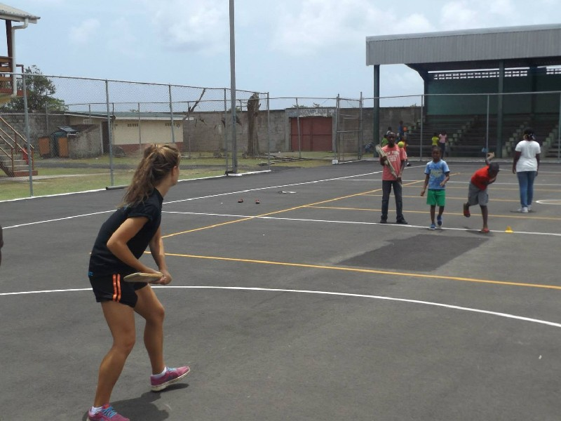 Cricket coach working at summer camp in the Caribbean