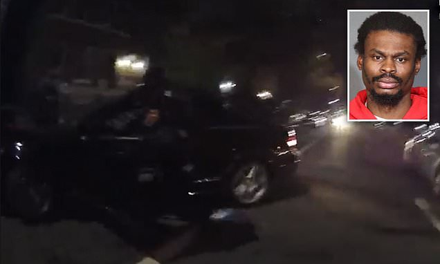 NYPD officer knocked over as driver reverses into him at