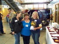Karen St. John First Women Queen of the Creek National Panning Champion with 2 of the Volunteers having Fun