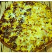 My homemade thin-crust breakfast pizza one half codfish veggies, other half turkey bacon and veggies