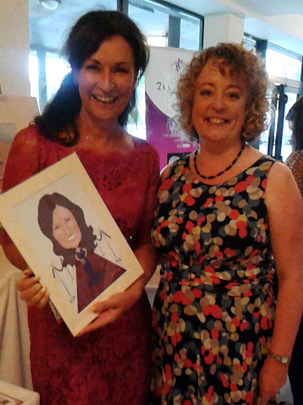 Celia Holman Lee with her caricature and me with flat hair and a big grin