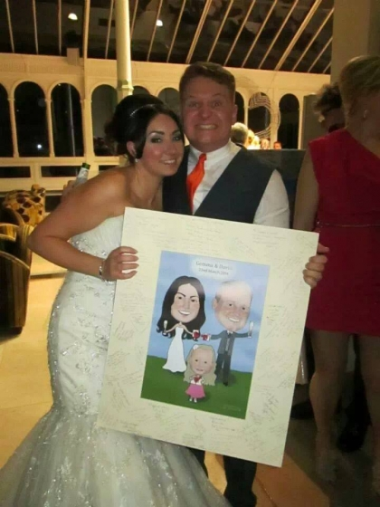Bride & Groom in Liverpool, UK with their Caricatures by Carmel Caricature Guest Signing Board