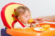 baby eating oranges
