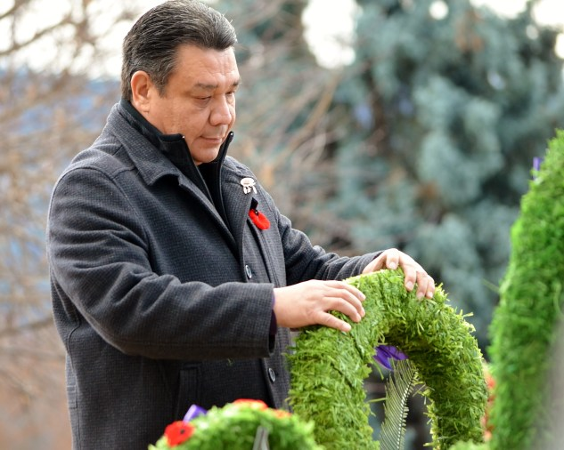 Councillor Allan Louis lays a Remembrance Day wreath for the Okanagan Indian Band at the Coldstream Remembrance Day Ceremony, 2015.