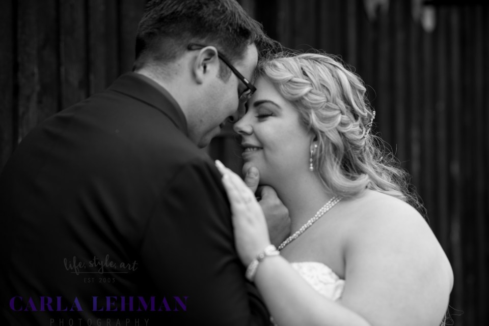 A sweet and tender moment between a bride and groom in Camrose Alberta.