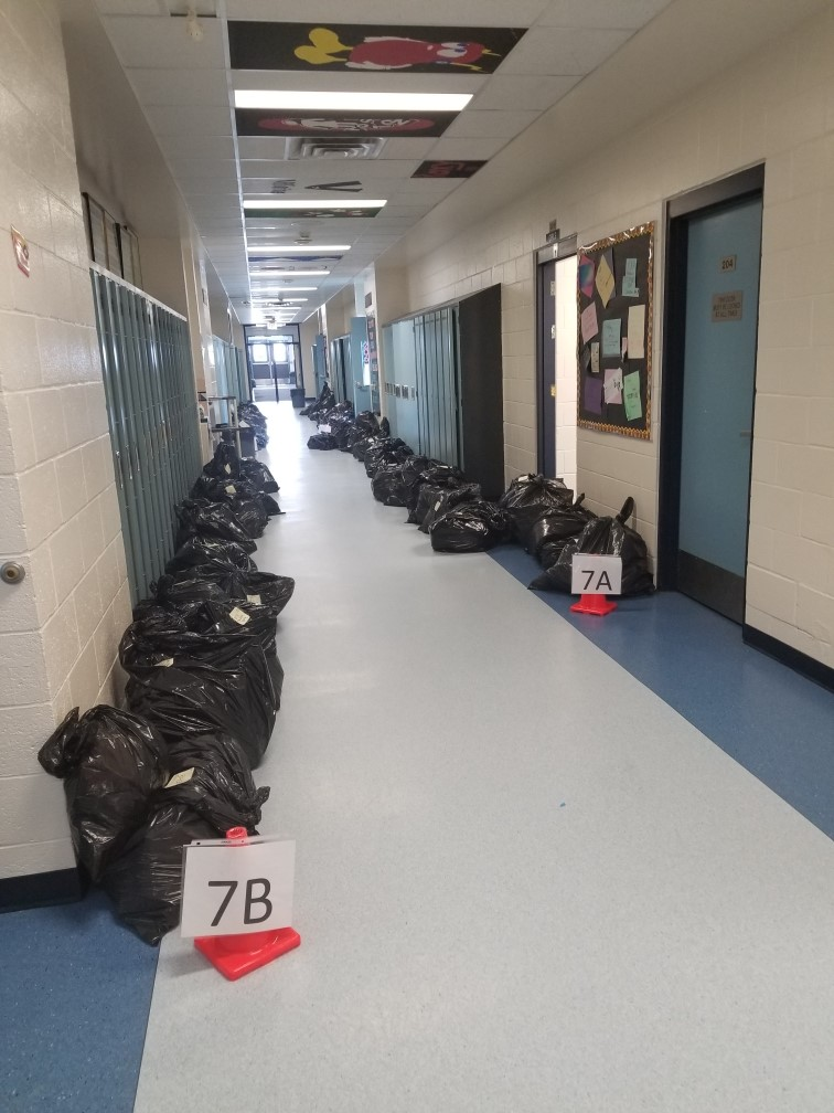 Image provided by Tofield School, Student's belongings, bagged and awaiting pickup Documentary Photo Essay