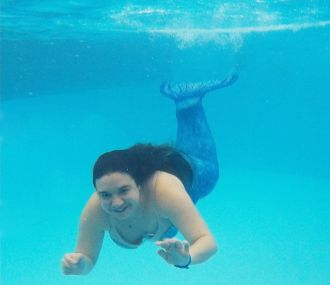 Carla in a mermaid tail   Be the one who people talk about   Carla Louise