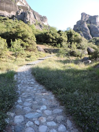 A dirt path gave way to this cobbled one that continued up and up, away from the village and toward the mountainous hills.