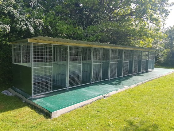 The Finished Job - A full set of roofed dog pens ready for use. All pens installed, set up and tested. The whole site clean and ready for use.