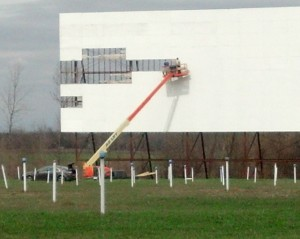 Screen being repaired at 56 Auto Drive-In